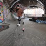 Lingling slalom on her skateboard